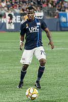 FOXBOROUGH, MA - SEPTEMBER 21: Cristian Penilla #70 of New England Revolution passes the ball during a game between Real Salt Lake and New England Revolution at Gillette Stadium on September 21, 2019 in Foxborough, Massachusetts.