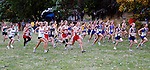High school girls from a dozen schools start our on the first lap of a 10K race during the Fort Worden Invitational at Fort Worden State Park.