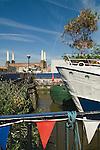 Tideway Village houseboats. Battersea South London UK . Battersea Power Station in background.