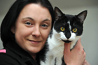 Pictured: Danielle pictured with Oscar.<br /> A cat named Oscar has been returned home after going missing since before last Christmas. Oscar was returned from Kent more than 200 miles from his home in Caerau, Cardiff. His owners Danielle, 27, and Rebecca, 28, Spencer are thrilled he has come home. They are urging all pet lovers to have their animals micro chipped .