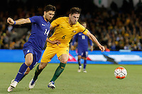 June 7, 2016: ANASTASIOS BAKASETAS (14) of Greece  and MILOS DEGENEK (6) of Australia compete for the ball during an international friendly match between the Australian Socceroos and Greece at Etihad Stadium, Melbourne. Photo Sydney Low