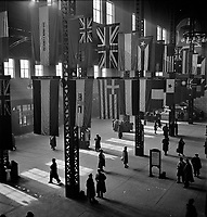 Crossroads of the World: Union Station concourse showing display the flags of the Allied Nations, Chicago, Illinois. January 1943.<br /> <br /> Photo by Jack Delano.
