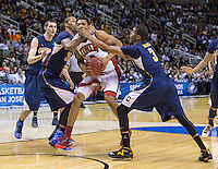 March 21st, 2013: California's Tyrone Wallace and Richard Solomon defending UNLV's Khem Birch during a game at HP Pavilion, San Jose, California. California defeated UNLV 64 - 61