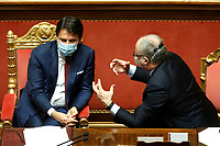 The Italian Premier Giuseppe Conte and the Italian Minister of Economy Roberto Gualtieri wearing a face mask, surrounded by insiders during the sitting at the Senate about the European Stability Mechanism (ESM).<br /> Rome (Italy), December 9th 2020<br /> Photo Samantha Zucchi Insidefoto