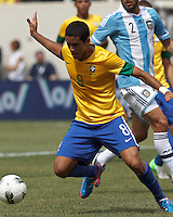 Brazil midfielder Romulo (8) controls the ball during a scoring effort. In an international friendly (Clash of Titans), Argentina defeated Brazil, 4-3, at MetLife Stadium on June 9, 2012.