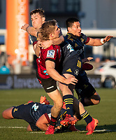 Michael Collins tackles Jack Goodhue during the 2020 Super Rugby match between the Crusaders and Highlanders at Orangetheory Stadium in Christchurch, New Zealand on Saturday, 9 August 2020. Photo: Joe Johnson / lintottphoto.co.nz