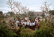 Danang, February 1988. Community work on the beach of Danang. Group of US Veterans posing in front of the Danang Beach Hotel.