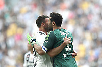 Calcio, Serie A: Juventus - Hellas Verona, Torino, Allianz Stadium, 19 maggio, 2018.<br /> Juventus' Captain and goalkeeper Gianluigi Buffon (r) embraces his teammate Andrea Barzagli (l) as he is substituted off during the during the Italian Serie A football match between Juventus and Hellas Verona at Torino's Allianz stadium, 19 May, 2018.<br /> Juventus won their 34th Serie A title (scudetto) and seventh in succession.<br /> Gianluigi Buffon played his last match with Juventus today after 17 years.<br /> UPDATE IMAGES PRESS/Isabella Bonotto