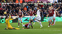Pictured: Wayne Routledge of Swansea (in white) has his shot stoped by Adrian (L) goalkeeper for West Ham Saturday 10 January 2015<br /> Re: Barclays Premier League, Swansea City FC v West Ham United at the Liberty Stadium, south Wales, UK