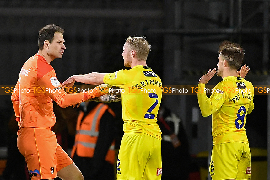 Asmir Begovic of AFC Bournemouth and Jack Grimmer of Wycombe Wanderers argue re a foul by Alex Pattison of Wycombe Wanderers right who was later sent off during AFC Bournemouth vs Wycombe Wanderers, Sky Bet EFL Championship Football at the Vitality Stadium on 15th December 2020