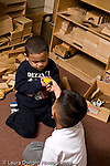 Education preschoool children ages 3-5 conflict argument two boys struggle over possession of toy vertical