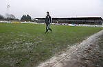 Brechin v St Johnstone....12.03.11  Scottish Cup Quarter Final.Ref Steve Conroy inspects the waterlogged Glebe Park pitch.Picture by Graeme Hart..Copyright Perthshire Picture Agency.Tel: 01738 623350  Mobile: 07990 594431