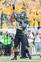 Baylor running back Shock Linwood (32) celebrates touchdown during first half of NCAA inaugural Football game at newly constructed McLean Stadium, Sunday, August 31, 2014 in Waco, Tex. Baylor leads SMU 31-0 in the first half. (Mo Khursheed/TFV Media via AP Images)
