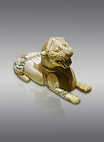 Phrygian ivory statuette carved as a roaring lion lying down from a table base decoration. From Gordion. Phrygian Collection, 8th-7th century BC - Museum of Anatolian Civilisations Ankara. Turkey.