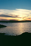 Sunset over Atlantic Salmon aquaculture pens, Cobscook Bay, Bay of Funday, Maine