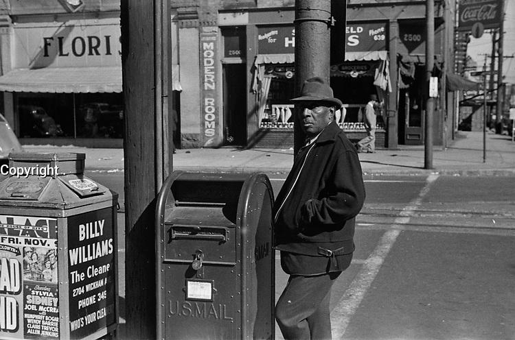 Street corner in Newport News, Virginia, November 1937.<br /> <br /> Photo by John Vachon.