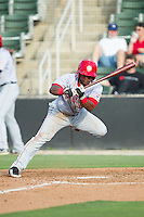 Wilmer Difo (6) of the Hagerstown Suns gets out of the way of an inside pitch during the game against the Kannapolis Intimidators at CMC-Northeast Stadium on May 31, 2014 in Kannapolis, North Carolina.  The Intimidators defeated the Suns 3-2 in game one of a double-header.  (Brian Westerholt/Four Seam Images)