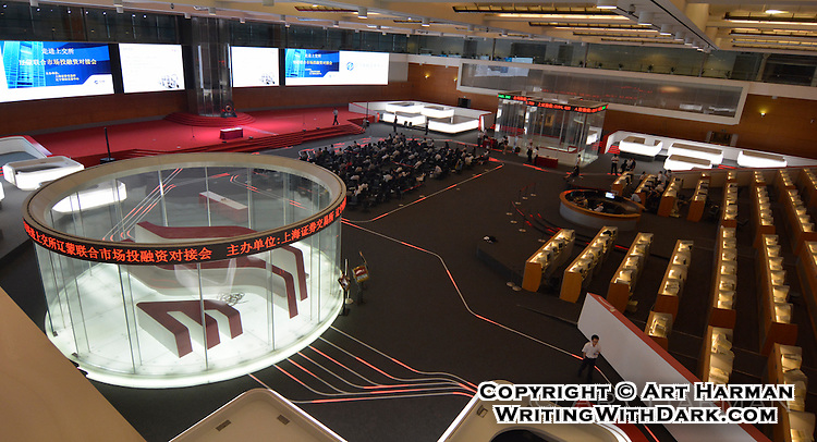 Shanghai's stock exchange seems designed like a giant video game. Moving lights on the floor complete the picture.