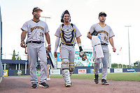Bradenton Marauders pitching coach Fernando Nieve (38), catcher Endy Rodriguez (5), and pitcher Logan Hofmann (26) walk to the dugout before Game Three of the Low-A Southeast Championship Series against the Tampa Tarpons on September 24, 2021 at George M. Steinbrenner Field in Tampa, Florida.  (Mike Janes/Four Seam Images)