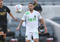 LOS ANGELES, CA - APRIL 17: Diego Fagundez #14 of Austin FC chases a loose ball during a game between Austin FC and Los Angeles FC at Banc of California Stadium on April 17, 2021 in Los Angeles, California.