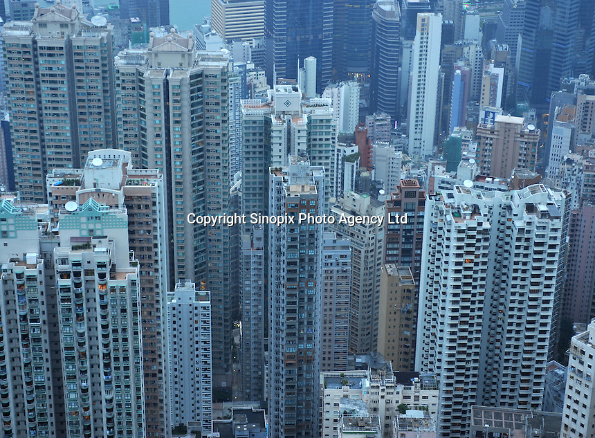 Hong Kong property packed together as seen from the Peak in Hong Kong. Hong Kong has some of the most expensive real estate in the world..