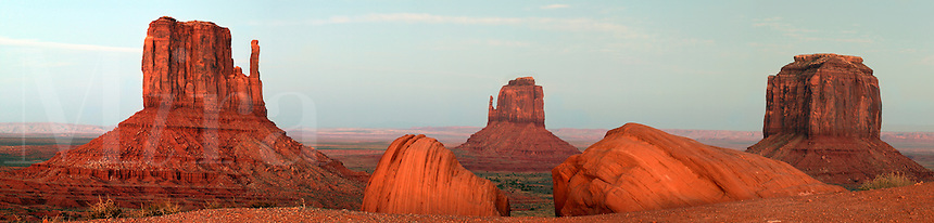 Panoramic photo of Monument Valley Navajo Tribal Park at sunset, Arizona.  Starting from left to right are West Mitten Butte, East Mitten Butte and Elephant Butte.  This image consists of five 11mp images
