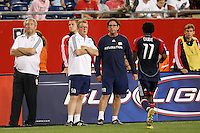 New England Revolution head coach Steve Nicol and assistant coach Paul Mariner talk with forward Kheli Dube (11) during a break in the action. The New England Revolution defeated Pachuca CF 1-0 during a Group B match of the 2008 North American SuperLiga at Gillette Stadium in Foxborough, Massachusetts, on July 16, 2008.