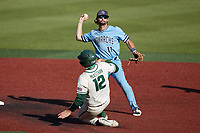 Old Dominion Monarchs shortstop Tommy Bell (11) makes a throw to first base after forcing Aaron McKeithan (12) of the Charlotte 49ers out at second base at Hayes Stadium on April 25, 2021 in Charlotte, North Carolina. (Brian Westerholt/Four Seam Images)