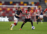 7th November 2020; Brentford Community Stadium, London, England; English Football League Championship Football, Brentford FC versus Middlesbrough; Hayden Coulson of Middlesbrough challenges Rico Henry of Brentford