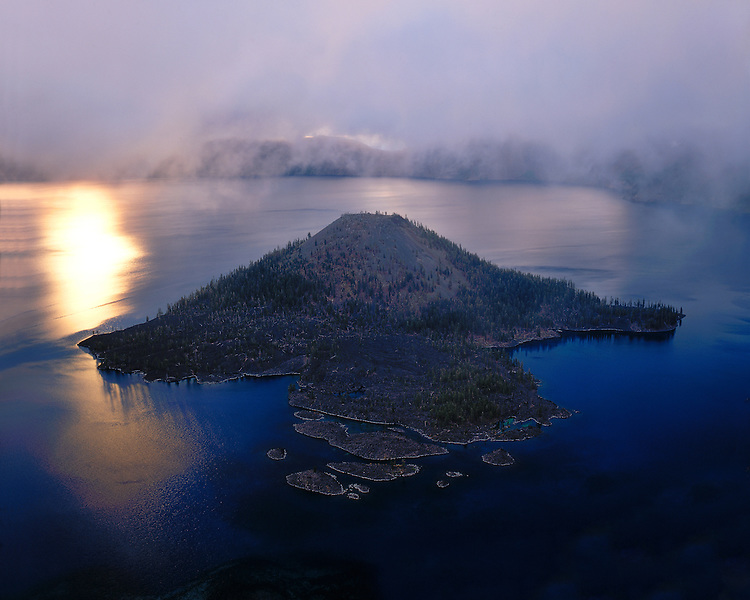 Foggy sunrise over Wizard Island; Crater Lake National Park, OR