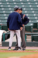June 3, 2009:  Manager Dave Brundage of the Gwinnett Braves argues a call with first base umpire Manuel Gonzalez during a game at Frontier Field in Rochester, NY.  The Gwinnett Braves are the International League Triple-A affiliate of the Atlanta Braves.  Photo by:  Mike Janes/Four Seam Images