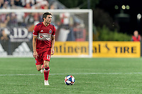 FOXBOROUGH, MA - AUGUST 25: Brandt Bronico #13 of Chicago Fire looks to pass during a game between Chicago Fire and New England Revolution at Gillette Stadium on August 24, 2019 in Foxborough, Massachusetts.
