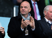 FIFA President Gianni Infantino applauds as he watches from the stands during the Barclays Premier League match between Swansea City and Norwich City played at The Liberty Stadium, Swansea on March 5th 2016