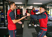 Angel Rangel and Roque Mesa exercise in the gym during the Swansea City Training and Press Conference at The Fairwood Training Ground, Swansea, Wales, UK. Thursday 24 August 2017