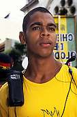 Salvador, Bahia, Brazil. Young African Brazilian steward for the carnival procession with radio and earpiece.
