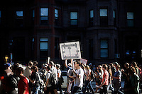 Protesters from the OccupyBoston movement walk through the streets of the Back Bay area of Boston, Massachusetts, USA.  The area is a high-traffic shopping area. The protesters are part of  OccupyBoston, which is part of the OccupyWallStreet movement, expressing discontent with the socioeconomic situation of the 99% of the US population who are not wealthy.  Protestors have been camping in Dewey Square since Sept. 30, 2011. Gradually, larger organizations, including major labor unions, have expressed their support for the OccupyBoston effort.