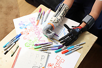 Pictured: Alan Gifford drawing. Friday 18 August 2017<br /> Re: 11 year old Alan Gifford who has two prosthetic arms, Loughor near Swansea, Wales, UK.