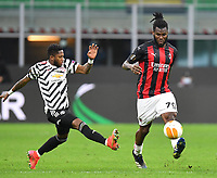 18th March 2021; San Siro stadium, Milan, Italy;  AC Milans Frank Kessie challenged by Manchester Uniteds Fred during the Europa League round of 16 second leg match between AC Milan and Manchester United in Milan, Italy