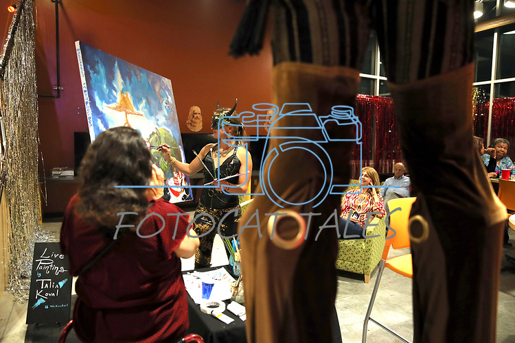 Dozens of artists from around the state of Nevada including Talia Koval, paints live at the annual Capital Collage in Carson City, Nev., on Friday, October 27, 2017. <br /> Photo by Lance Iversen/Nevada Momentum