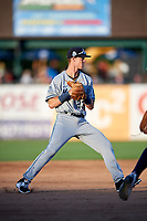 West Michigan Whitecaps shortstop Cam Warner (23) throws to first base during a game against the Kane County Cougars on July 19, 2018 at Northwestern Medicine Field in Geneva, Illinois.  Kane County defeated West Michigan 8-5.  (Mike Janes/Four Seam Images)