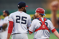 Louisville Bats starting pitcher Amir Garrett (25) talks with catcher Chris Berset (10) during a game against the Buffalo Bisons on June 22, 2016 at Coca-Cola Field in Buffalo, New York.  Buffalo defeated Louisville 8-1.  (Mike Janes/Four Seam Images)