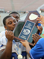 Armwood Hawks linebacker Keionne Baines #32 kisses the trophy after the Florida High School Athletic Association 6A Championship Game at Florida's Citrus Bowl on December 17, 2011 in Orlando, Florida.  Armwood defeated Miami Central 40-31.  (Mike Janes/Four Seam Images)