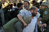 Jewish settlers scuffle with Israeli soldiers, after the army evicted settlers from a disputed building in Hebron, West Bank..Israeli high court recently rejected the settlers' claim that they legally bought the house from its Palestinian owner. The few families living there were joined by a mob of some 1500 radical right-wing youth, who went on a rampage and attacked Palestinians in the mixed West Bank city..December 4, 2008 (Photo by Ahikam Seri).