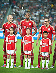 GUANGZHOU, GUANGDONG - JULY 26:  Arjen Robben, Jerome Boateng and Franck Ribery of Bayern Munich pose with chinese young fans before a friendly match against VfL Wolfsburg as part of the Audi Football Summit 2012 on July 26, 2012 at the Guangdong Olympic Sports Center in Guangzhou, China. Photo by Victor Fraile / The Power of Sport Images