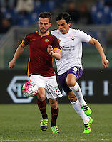 Calcio, Serie A: Roma vs Fiorentina. Roma, stadio Olimpico, 4 marzo 2016.<br /> Roma's Miralem Pjanic, left, is challenged by Fiorentina's Tino Costa during the Italian Serie A football match between Roma and Fiorentina at Rome's Olympic stadium, 4 March 2016.<br /> UPDATE IMAGES PRESS/Riccardo De Luca