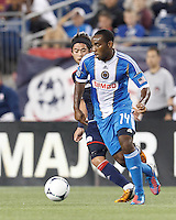 Philadelphia Union defender Amobi Okugo (14) dribbles at midfield. In a Major League Soccer (MLS) match, the New England Revolution tied Philadelphia Union, 0-0, at Gillette Stadium on September 1, 2012.