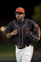 AZL Giants Black left fielder Franklin Labour (49) jogs off the field between innings of an Arizona League game against the AZL Royals at Scottsdale Stadium on August 7, 2018 in Scottsdale, Arizona. The AZL Giants Black defeated the AZL Royals by a score of 2-1. (Zachary Lucy/Four Seam Images)