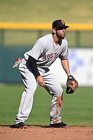 Surprise Saguaros infielder Deven Marrero (11) during an Arizona Fall League game against the Mesa Solar Sox on October 17, 2014 at Cubs Park in Mesa, Arizona.  Mesa defeated Mesa 5-3.  (Mike Janes/Four Seam Images)