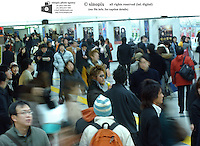Shinjuku JR train station during peak hours in Tokyo, Japan. Shinjuku is the busiest railway station in the world with several million comuters passing through daily.