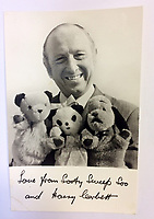 "BNPS.co.uk (01202 558833)<br /> Pic: Hansons/BNPS<br /> <br /> Pictured: Harry Corbett signed photo being auctioned along with the Sooty puppet.<br /> <br /> An iconic old Sooty TV puppet which Harry Corbett gave to a friend has emerged for sale for £1,200.<br /> <br /> The children's show inventor Harry Corbett gifted it to biology teacher Paul Mouncey, from Comrie, Perthshire, Scotland, in the mid-1970s.<br /> <br /> His daughter Tina Stewart, a veterinary receptionist from Dunblane, is now selling the hand puppet with Hanson's Auctioneers, of Etwall, Derbys.<br /> <br /> Mrs Stewart, a veterinary receptionist from Dunblane, Scotland, said: ""We took Sooty along with us and after the show met Richard - who immediately new our puppet was an original."